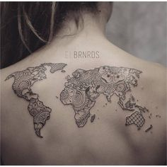 Ornamental style world map on the upper back. Tattoo artist: Elda Bernardes