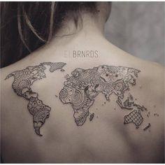 Ornamental style world map on the upper back. Tattoo artist: Elda Bernardes