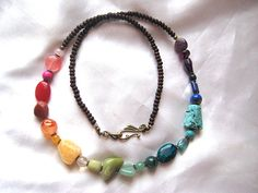 Brighten any day, and any outfit with this fun, colorful necklace.    A rainbow of gemstones, including: turquoise, jasper, agate, amethyst,