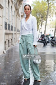 Aimee Song poses wearing Chloe after the Chloe show at the Maison Chloe during Paris Fashion Week Womenswear SS18 on September 28, 2017 in Paris, France.