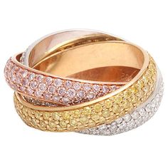Cartier Trinity ring with three colours of gold and three colours of diamonds.