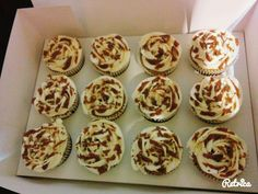 Banofee cupcakes. Banana cake with a caramel core centre decorated with vanilla buttercream, drizzled with caramel and grated chocolate