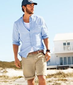 Chino shorts and light blue shirt.