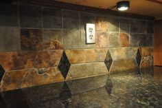 I love this tile with diamond cut outs that match the granite!