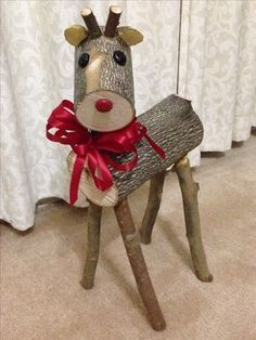 My first log reindeer. My little Rudolf and my most favorite of the 4.
