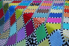 Love the striped sashing -- it adds such a zing to the quilt.