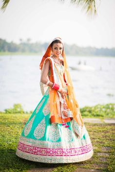 turquoise lehenga , spinning bride , beach side wedding lehenga , turquoise and peach lehenga