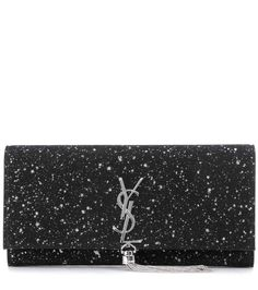 Saint Laurent - Classic Monogram glitter suede clutch - The 'Classic Monogram' style is crafted from a glamorous dark black suede with a splattered print of silver-tone glitter, and is finished with the brand's iconic monogram and chain tassel. - @ www.mytheresa.com