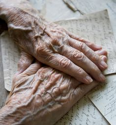 old hands covering precious letters of days gone by - remembering hands