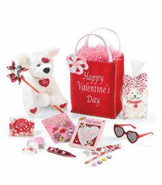 "happy valentine's day treat bag - Imagine your Valentine's eyes lighting up over this treat bag, filled with things red, white and cute all over. The plush puppy wears a red heart reading ""I'm Yours."" Included are a foil pinwheel, pink candy corn (yum!), heart-shaped playing cards, a kazoo (hum!) and Valentine tattoos. It'll be fun to complete the activity book with the heart-covered pencil, eraser and sticker set. Glitter sunglasses and -- sweetest of all -- a 6"" sugar cookie puppy."