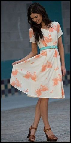Love this dress - the material looks very soft and flowing which I like. Love her shoes too - gorgeous outfit for work.