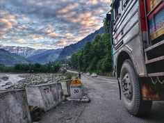 """A Perfect Picture for Me! Why? Because it features well a Truck  a river stream snow cappee mountain peaks and a Highway! Not an ordinary Highway as it leads to the mighty-famous Rohtang Pass!! Captured this frame at 5am in the morning during a walk towards Jogini Falls. Mood was like """"Naach le gali gali Le Naam Ali Ali""""  . . . . . ."""