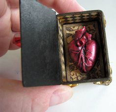 Snow White's heart in a box. Matchbox, polymer clay. By L. Mahaffey