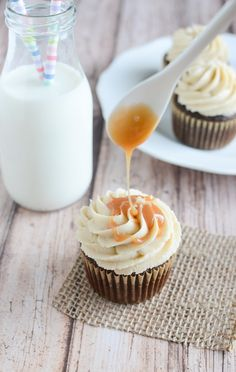 Delicious Chocolate Cupcakes with Whiskey Caramel Sauce pair perfectly with a cold glass of milk! =