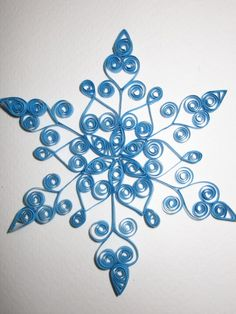 This snowflake is made out of 36 strips of soft blue paper each hand rolled or quilled.