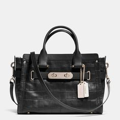 Named for a bold, brass-trimmed Bonnie Cashin design from the spacious, modern Coach Swagger carryall is finished by hand in tactile croc-embossed leather with a detachable strap for shoulder or crossbody wear. How To Make Handbags, Coach Handbags, Coach Purses, Coach Bags, Purses And Bags, Coach Men, Women's Bags, Leather Handbags, Women's Handbags