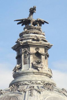 Two views of the stone plinth on which the dragon rests that rises from the dome of City Hall. Description from victorianweb.org. I searched for this on bing.com/images