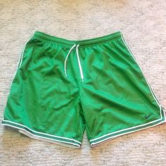 Nike women's basketball shorts Green and white mesh Nike women's basketball shorts, large. Never worn. Only problem with them is that I cut the tags off  No stains. Nike Shorts