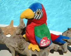 Ty Beanie Baby Jabber Parrot Bird Macaw Bean Bag 1997 Original Beanie Baby Jabber Bird Parrot Macaw Birthday October 10 1997 Retired December 1999 New With Tags Red Blue Green Yellow Bean Bag Plush Stuffed Animal This adora. Baby Stuffed Animals, Dinosaur Stuffed Animal, Yellow Bean Bags, Original Beanie Babies, Parrot Bird, Repurposed Items, Ty Beanie, Diy Arts And Crafts, Beenie Babies