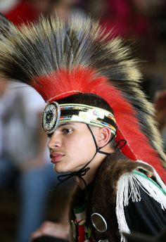 PresentWearing a Native American head dress, Kevin Chavis, of Pembroke, NC., waits to compete in the Prairie Chicken Dance division of the American Indian Festival  (Jason Getz, 2011)