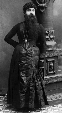 Madame Devere Guinness World Record holder for longest beard ever on a woman 14 inches. Madame Deveres real name was Jane and she was born in Brooksville Kentucky. She was married to sideshow manager J W Devere
