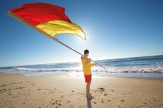 Volunteer Surf Life Savers help keep our beaches safe. Please swim between the flags this summer. :) #beach #queensland