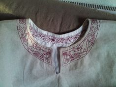 tunic outline front by Longship Traders, via Flickr  Gorgeous Doggy embroidery! My husband would love something like this for his tunic :)