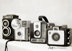 """""""Camera Line Up""""- A cool line up of some of my vintage cameras. Black and white fine art print. Professionally printed upon order. My photographs are professionally printed with archival inks on premi"""