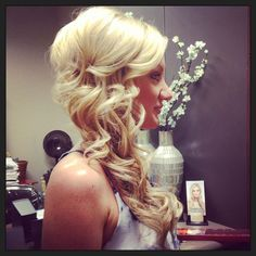 Looking for something different on your special day. Here you can put your hair to one side pinned with loose curls.