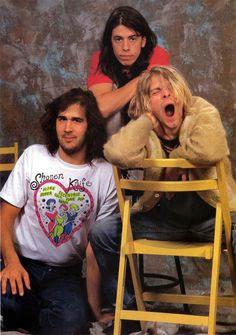 Nirvana - Kurt Cobain, Dave Grohl and Krist Novoselic.... I think Kurt is probably tired in this picture. Yet he looks fucking hot.