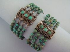 A set of sterling and turquoise bracelets made in China during the early 1900's.