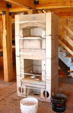 An ancient heating technology that's way more efficient than stoves made from metal. Tyni House, Tiny House Cabin, Stove Heater, Stove Oven, Soapstone Stove, Rocket Mass Heater, Wood Oven, Backyard Fireplace, Cooking Stove