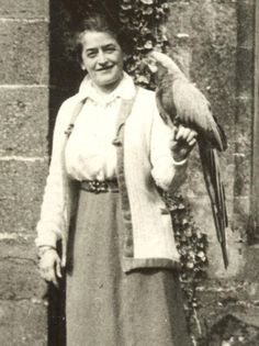 "Juliette Gordon Lowe-""Daisy"" with her African Gray Parrot, BlueBird. She founded Girl Scouts USA March 12, 1912. It's the 100th anniversary year."