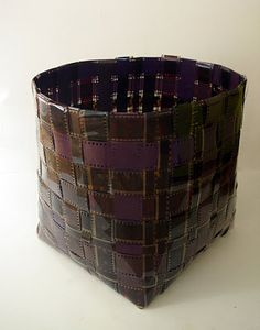 Isn't this basket, woven from rolls of 35mm and 16mm film, a great new use for old film? Probably fairly easy to make, if you know how to weave. (Want a good tutorial for that? Check the post for DIY basket-weaving info).