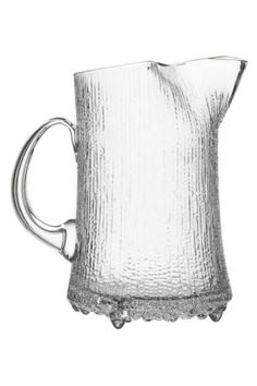 iittala Ultima Thule Ice Lip Pitcher. In modern literature, Ultima Thule is used to reference the furthest possible place in the world. Tapio Wirkkala's Ultima Thule glassware similarly references the icy cold reaches of Scandinaiva and the distinct expressive power of Finnish glass. Designed in 1968, Wirkkala's Ultima Thule contributed to iittala's national breakthrough and remains a distinctive iittala design.The Ultima Thule ice lip pitcher has textured sides that reference…