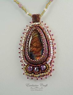 Unique beaded pendant with treated Labradorite, Amethyst beads, crystal and Japanese seed beads. Beautiful Labradorite cabochon changes colors as the light hits it from the different angles. Handcraft