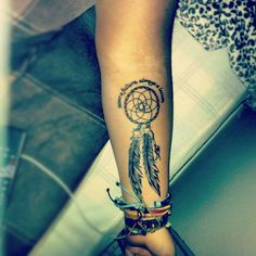 Sibling dream catcher tattoo. Two feathers for my brother and I. With the beads the color of our birth month.