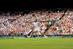 Roger Federer hits a volley on Centre Court