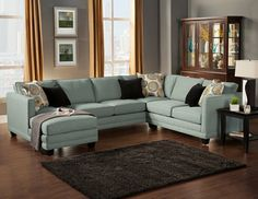 "3 pc Oasis collection Teal color fabric upholstered sectional sofa with square arms and chaise. This sectional measures 127"" x 64"" chaise x 68"" L x 35"" H x 38"" D.  SKU 	Oasis Sect Teal"