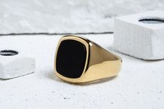 "This dignified signet ring takes its name from the Finnish word for ""rich."" It's a fitting title for a piece that is adorned with black onyx — a gemstone that h"