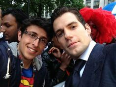 "FLASHBACK FAN PHOTO  George is a proud Supes fan and wore his colors proudly to the London premiere.  He captioned his photo,  ""Me and Superman (Henry Cavill) at the Man of Steel premiere."""