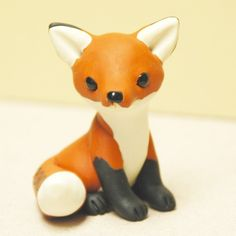 This little fox is reserved, so please dont purchase unless you are erinp123. It is about one and a half inches tall. It has black glass eyes and nose. It was hand sculpted by me, from Premo brand polymer clay, which is Sculpeys professional line and stronger than most other polymer clay brands.