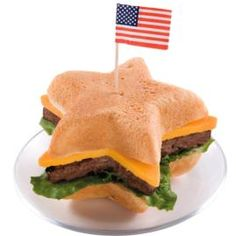 Serve up a pile of patriotic burgers. Sure to be a sensation at your next summertime celebration, these sandwiches boast buns baked in a Mini Star Pan and burgers formed with a metal star cookie cutter.  #fourth #of #july #fourthofjuly #party #idea #ideas #funideas #coolideas #food #foodie #yum #independence #day #family #fun #cookout #cookouts #grill #dessert #desserts #redwhiteandblue www.gmichaelsalon.com