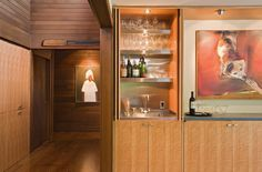 Conceal your home bar in a cupboard