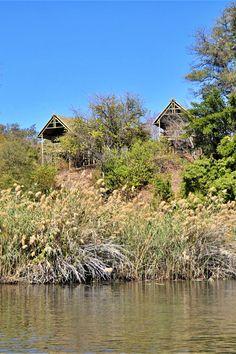 Sharwimbo River Camp is op die Kwandorivieroewer wat Botswana en Namibië skei. Dit bied gehalteverblyf aan 'n gesin of groep vriende. Dis 25 km suid van Kongola. Die verblyf beskik oor 15 rivierchalets en 6 kampeerplekke. Sharwimbo River Camp is situated on the banks of the Kwando which separates Botswana and Namibia. It offers quality accommodation for an family or group of friends. It is located 25 km South of Kongola. The accommodation comprises 15 River Chalets and 6 campsites. River Camp, Group Of Friends, Separates, Campsite, Banks, Cabin, House Styles, Chalets, Camping