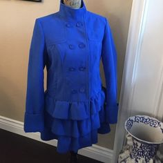 """Royal blue ruffle bottom coat NWOT Such a pretty blue! Super soft and fully lined, this beauty will keep you snuggly warm . 100% polyester, dry clean only.  Measures 21"""" from armpit to armpit and 32"""" from back neckline to bottom hem of ruffle tier #3. I am a 10-12 and it is tight on my big hips but I am able to button comfortably. The cuffed sleeves are long and you might need to alter FYI. It is gorgeous!  Xhilaration Jackets & Coats"""