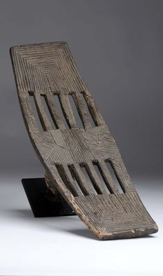 Africa | Backrest / headrest from the Kuba people of DR Congo | Wood; dark brown patina