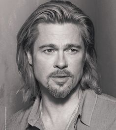 brad pitt.. making a mens long hair cut look easy and classic, hopefully this will catch on with the short back and sides guys:)