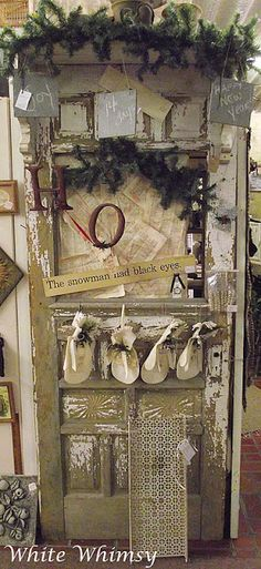Old Prim Chippy Door...decorated with pine for Christmas.