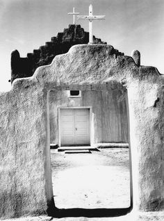 """""""Church, Taos Pueblo, New Mexico, 1942,"""" full front view of entrance. -Ansel Adams"""